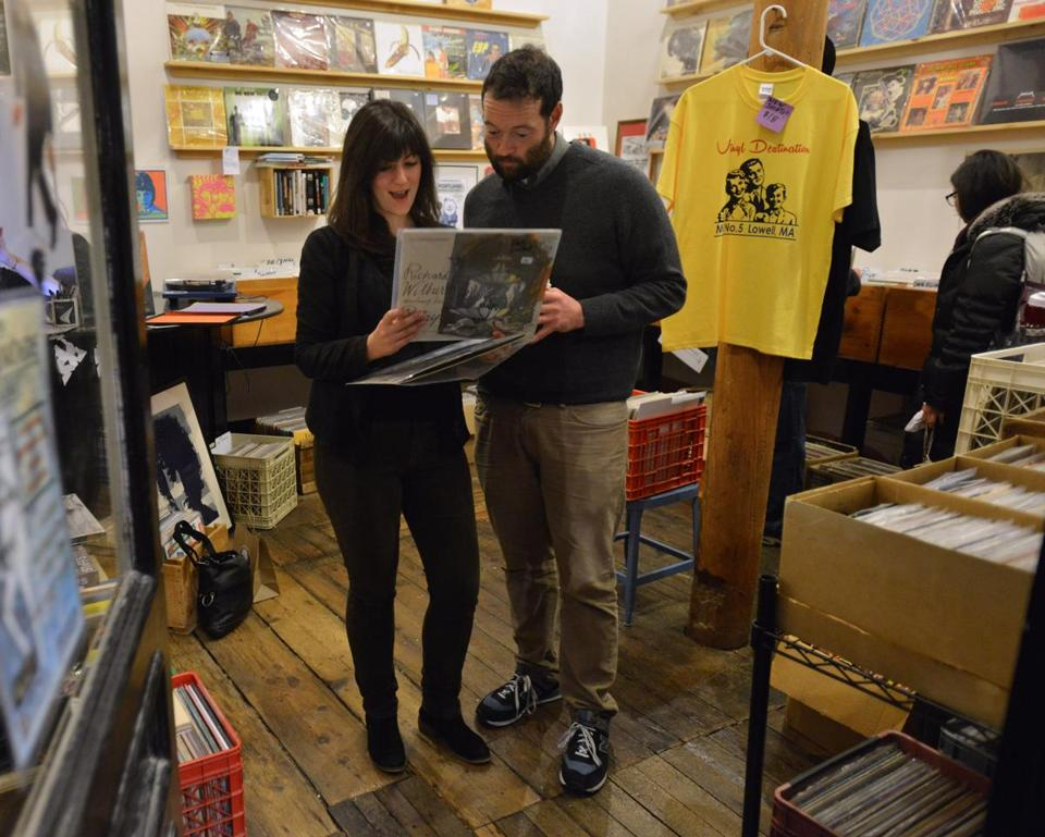 From left, Diana Collins of Cambridge, and friend Phil Martin of Medford shop for records at Vinyl Destination in Mill No. 5.